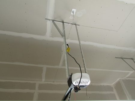 garage door opener plugged into extension cord