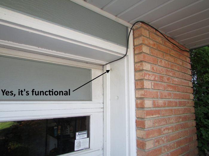 Garage door opener button at exterior