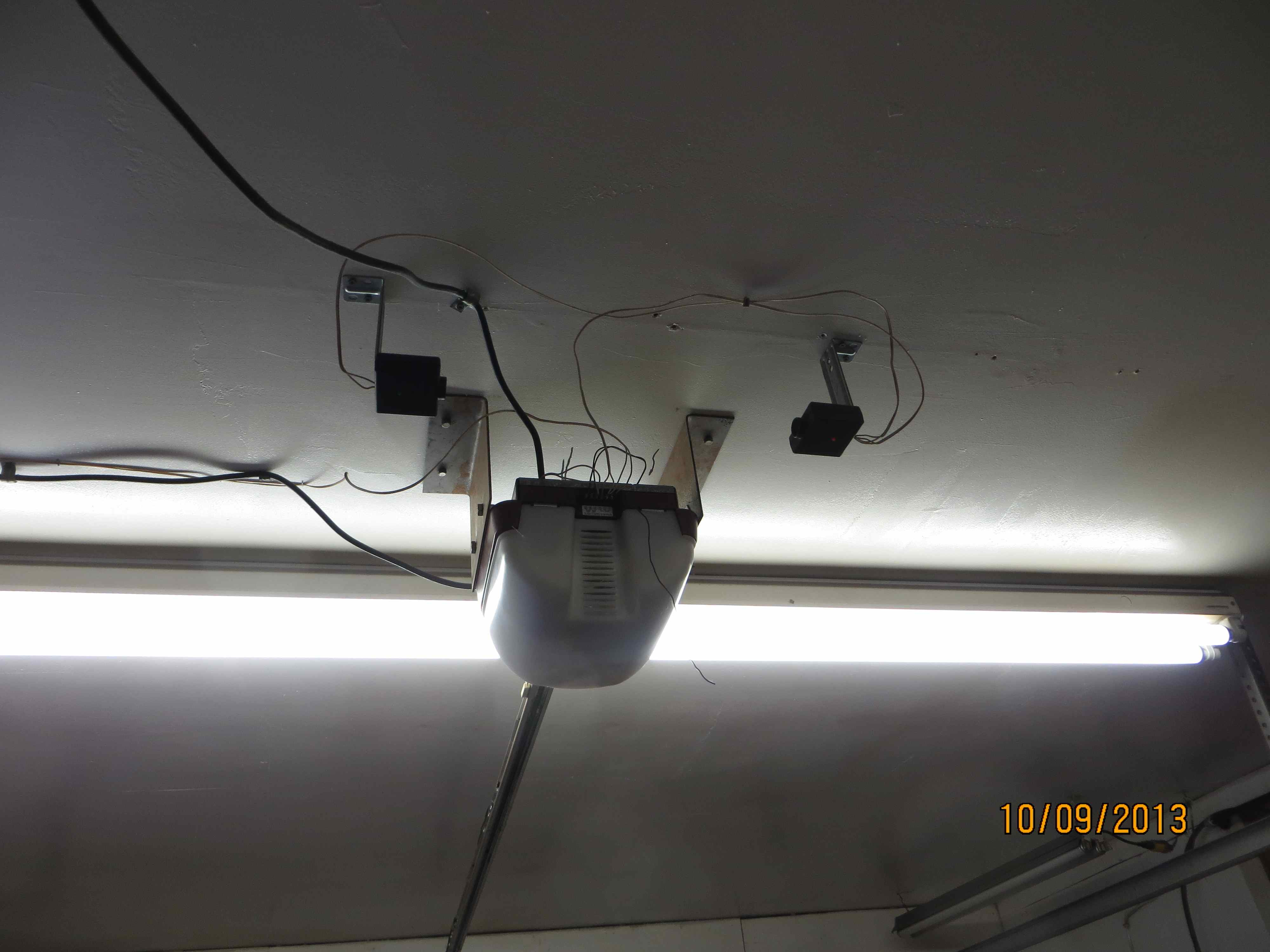 The Most Common Garage Door Opener Issues Way A Ceiling Rose Is Connected Assuming That Wiring Photoelectric Sensors At 12