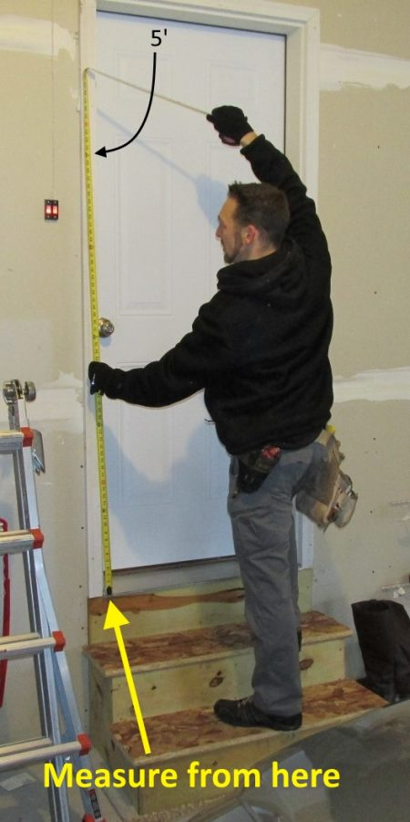Man measuring wall buttons installed too low | Construction Pro Tips