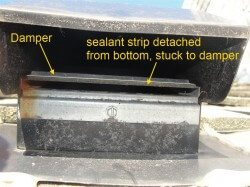 Sealant strip stuck at damper