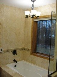 Chandelier over bath tub in Chaska