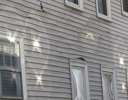 Melted vinyl siding caused by reflected sunlight