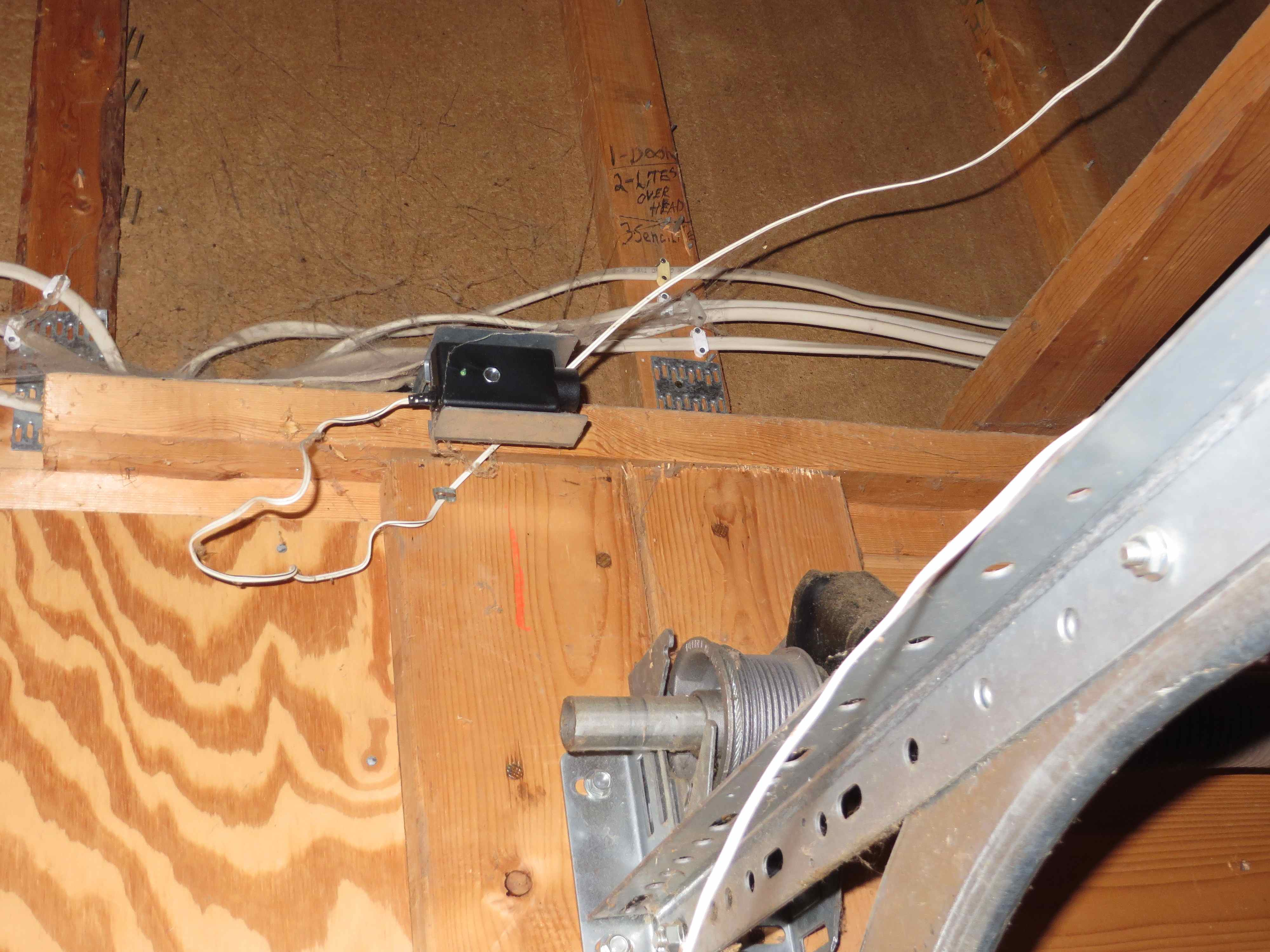The Most Common Garage Door Opener Issues Basic Wiring To Detached Journal Board Photoelectric Sensors At Ceiling 19