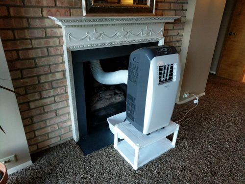 Room AC unit vented up the fireplace