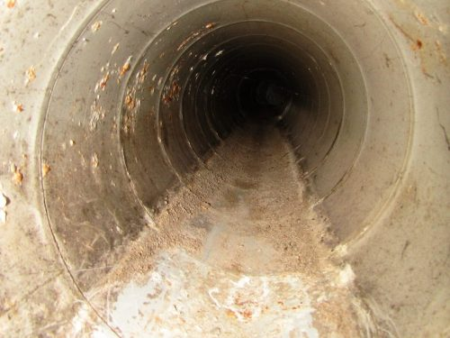 transite duct with water stains