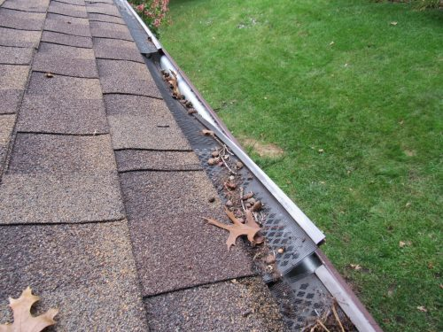Cheap gutter screen falling out of place