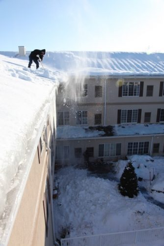 shoveling a tall roof