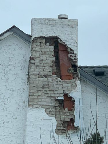 Damage at stucco-covered chimney
